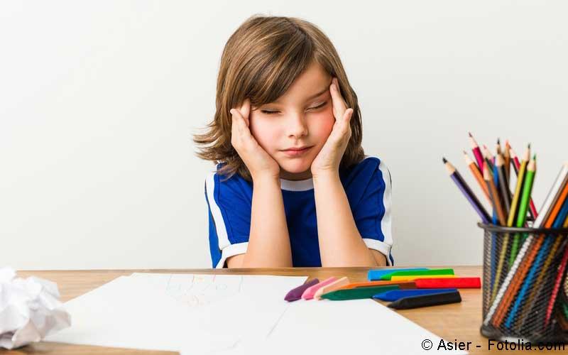 Kind mit Kopfschmerzen